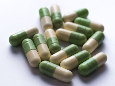 Cream and green capsules on a table