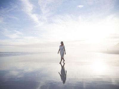 Woman walking alone on the beach