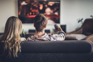 Rear view of a couple watching TV