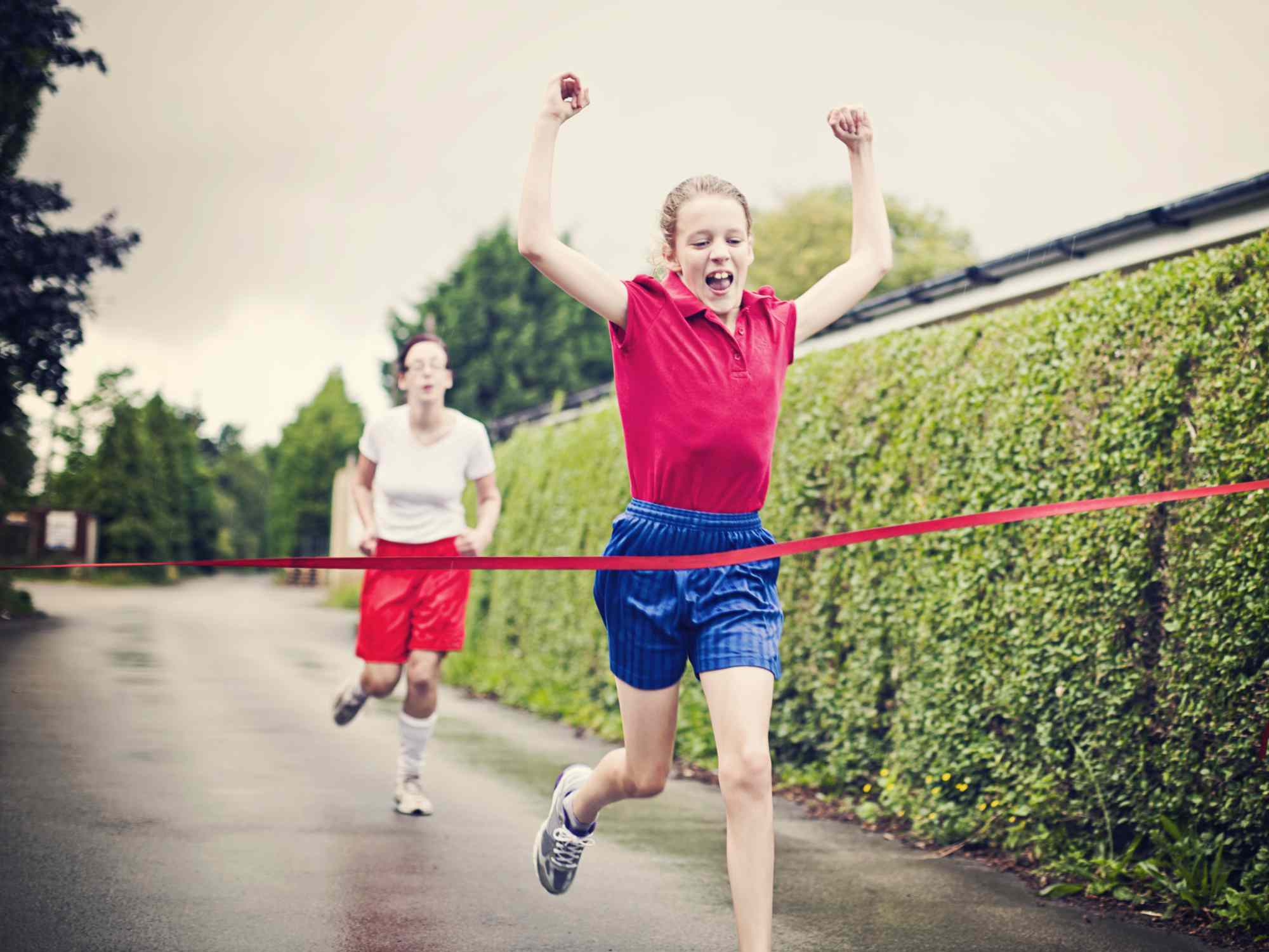 Child Crossing A Finish Line