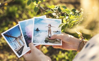Woman holding photographs