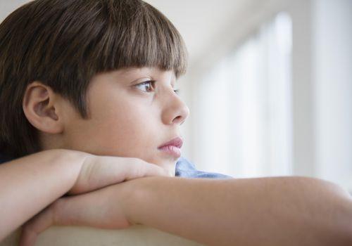 Portrait of pensive boy (8-9)