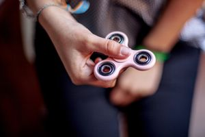 woman playing with a fidget spinner