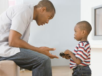 Father teaching son right from wrong