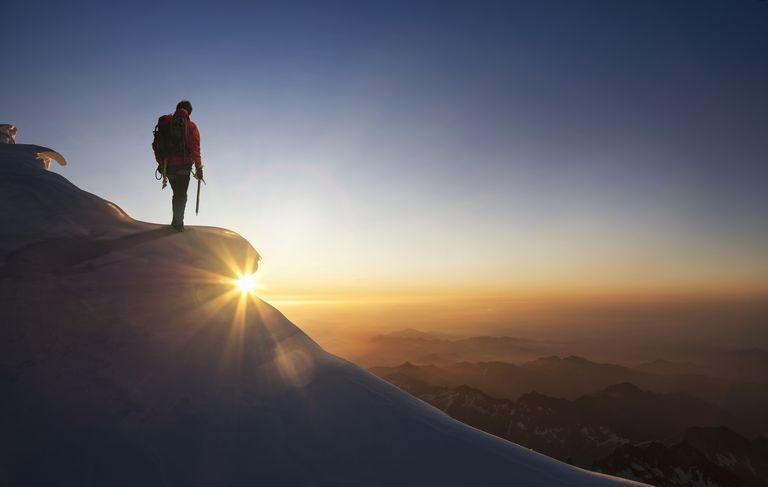 hiker on a mountain peak