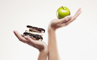 weighing chocolate against an apple
