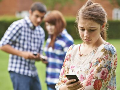 teen checking smartphone
