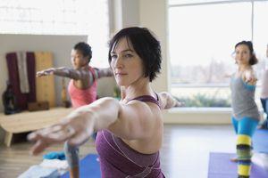 Woman participates in yoga class