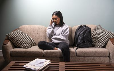 university student feeling stressed at home