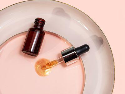 A bottle of CBD oil and a medicine dropper