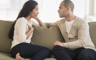 A picture of a man and a woman having a serious talk