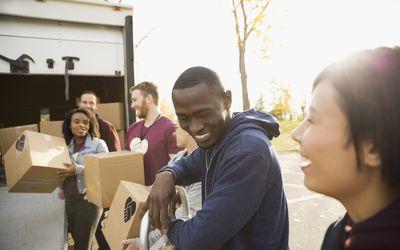 Volunteers helping unload truck