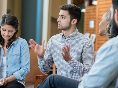 Young man participates in group therapy
