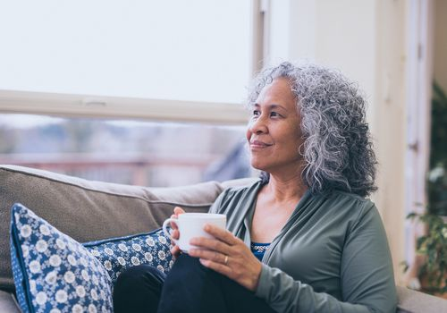 Woman relaxing and enjoying a cup of tea.