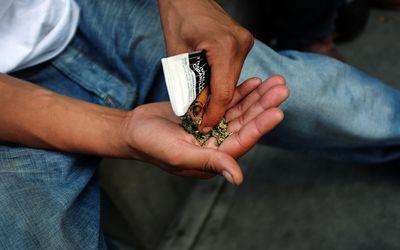 Man holding Synthetic Marijuana