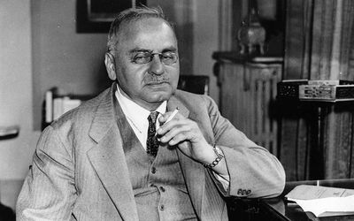Alfred Adler sitting in his office