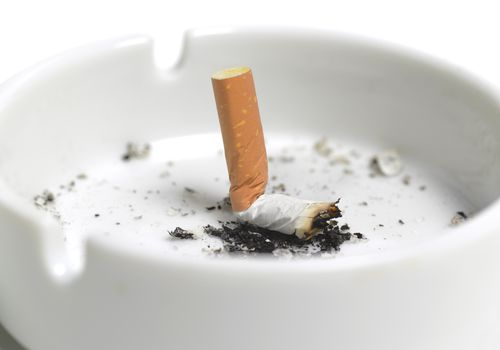 Cigarette butt crushed in an ashtray