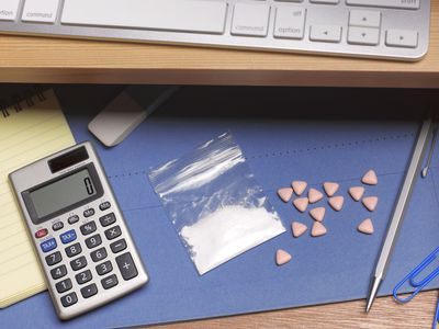 cocaine and ecstasy pills in office desk