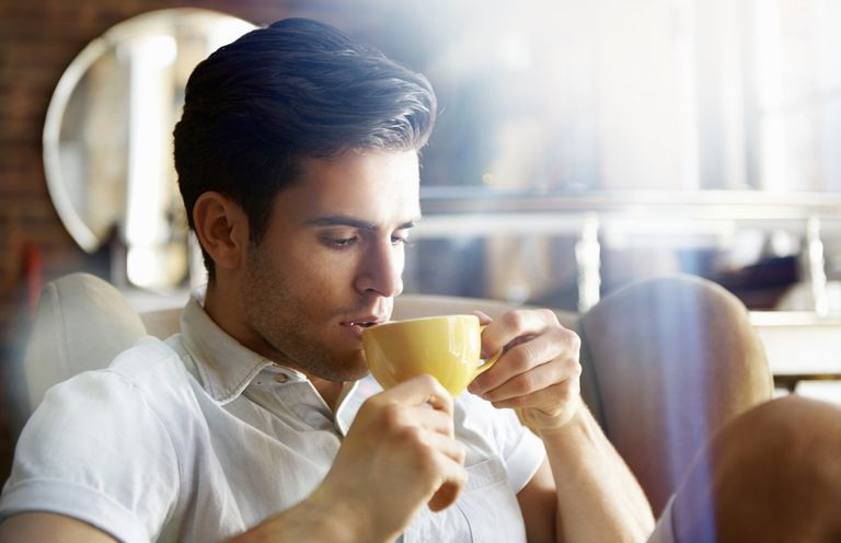 man in cafe drinking coffee