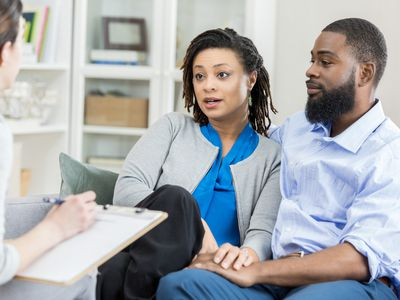 Married couple talks to counselor about relationship