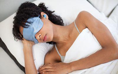 Woman sleeping with earplugs