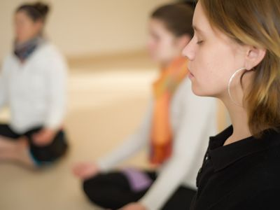 Group class sitting and meditating