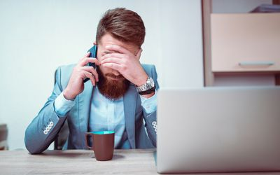 Man complaining about job on the phone