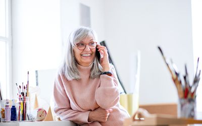 Woman smiling and using the phone