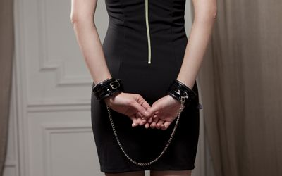A woman in handcuffs practicing BDSM