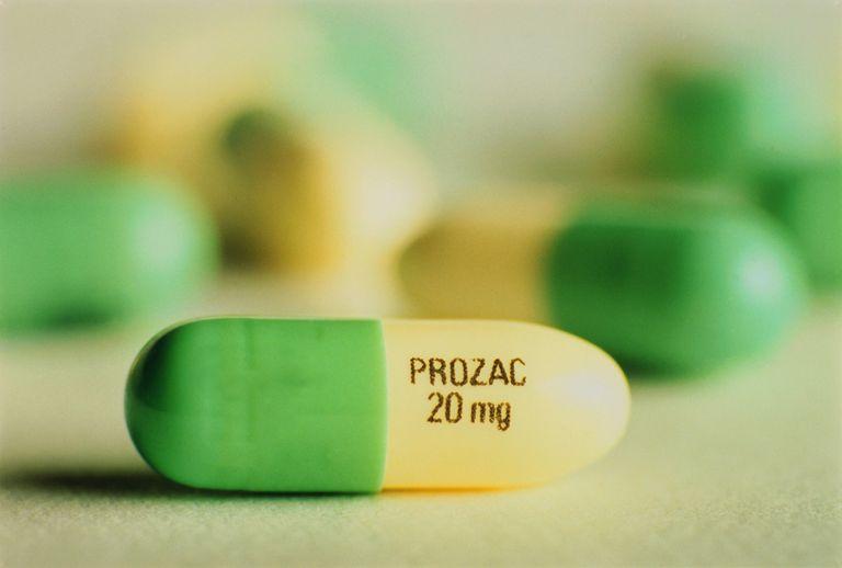 Prozac antidepressant pills on white surface,close-up