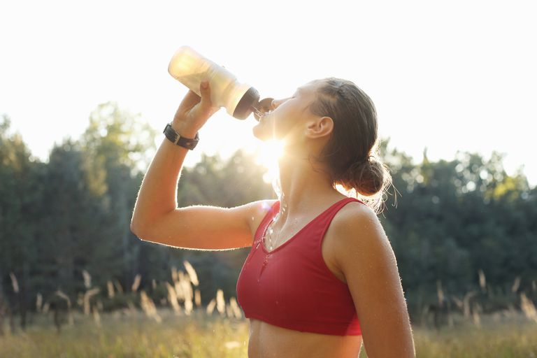 Woman drinking from a water bottle