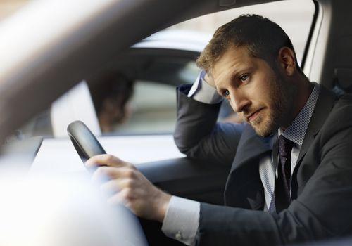 Man in car in traffic