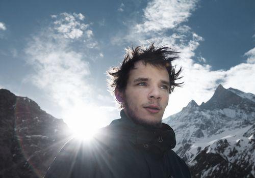 guy having an adventure on a mountain