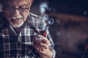 Old man smoking with pipe