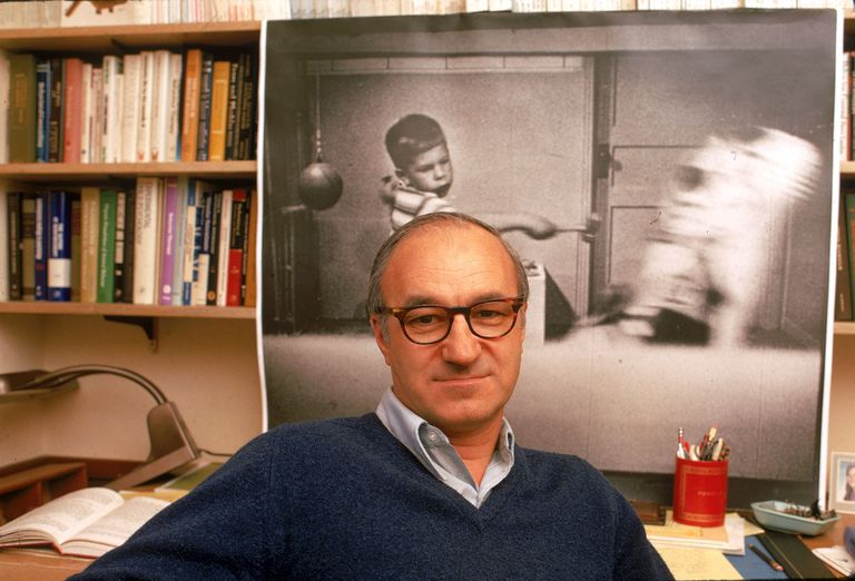 psychologist Albert Bandura sitting in offie