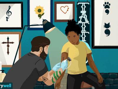 Getting a tattoo in a tattoo shop