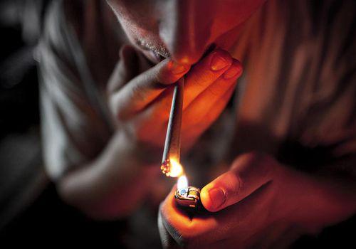 Man Lighting a Joint