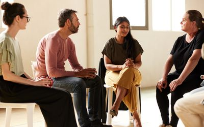 A businesswoman is talking in group training.