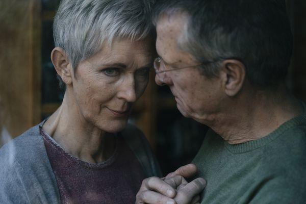 Senior man consoling sad wife