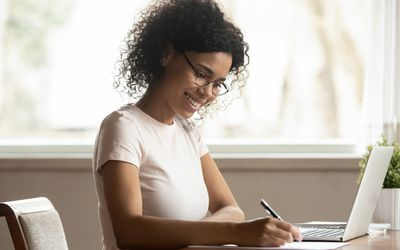 woman with laptop making a list