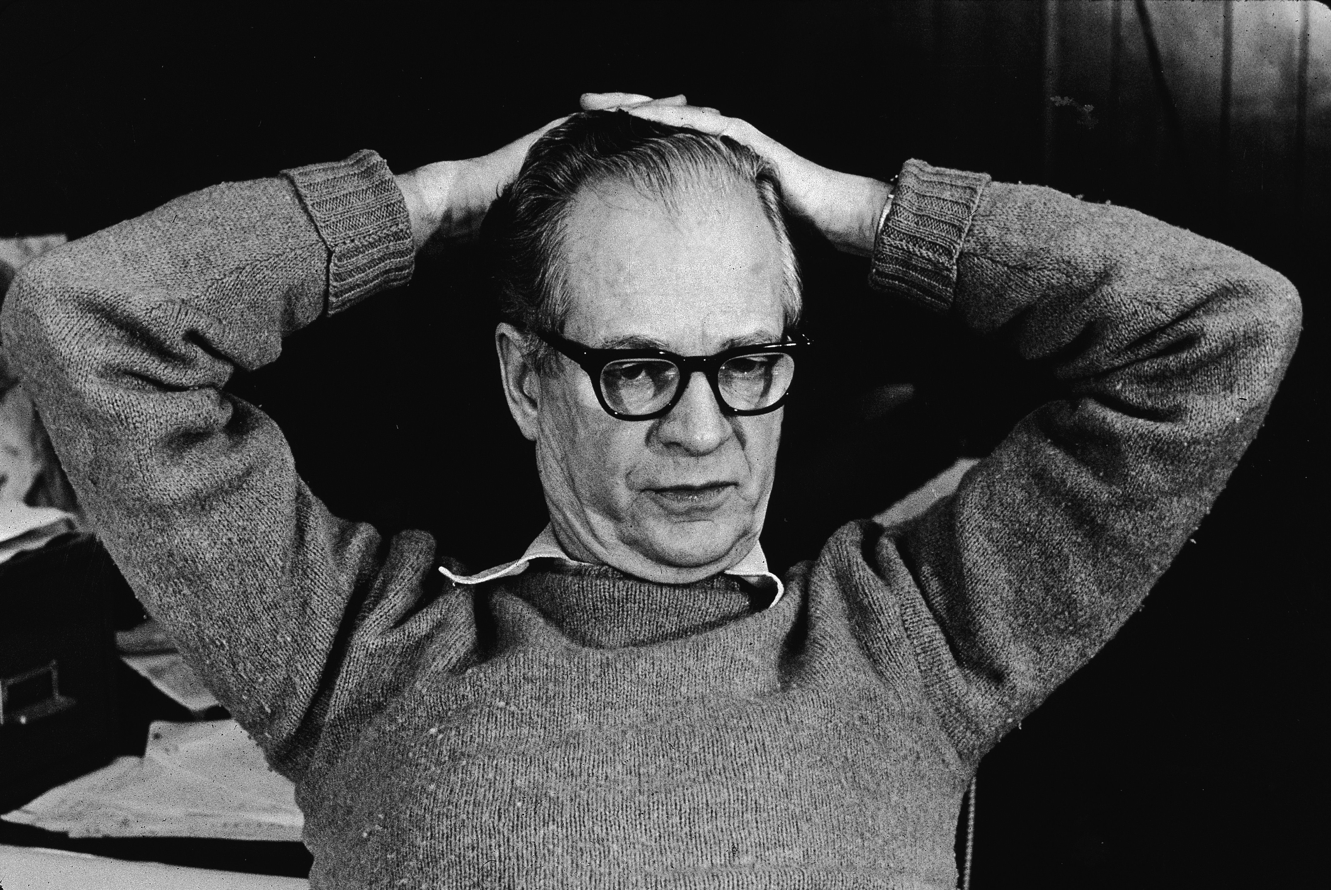 B. F. Skinner with his hands on top of his hand