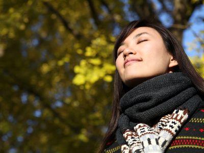 Woman enjoying the crisp cool autumn air