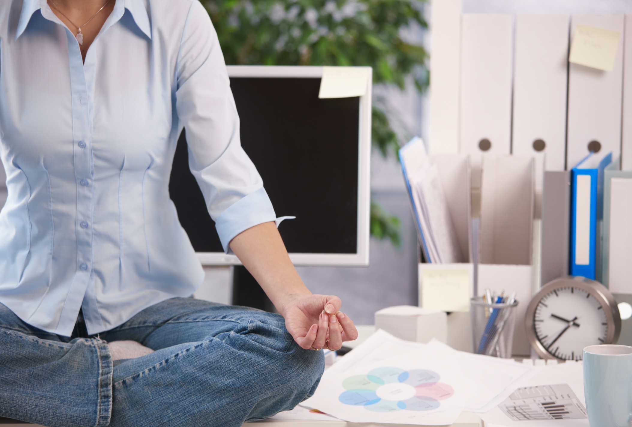 Meditating on a desk