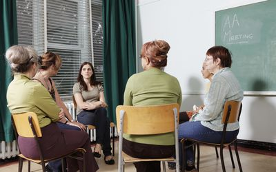 Diverse group of ladies at a group AA Meeting