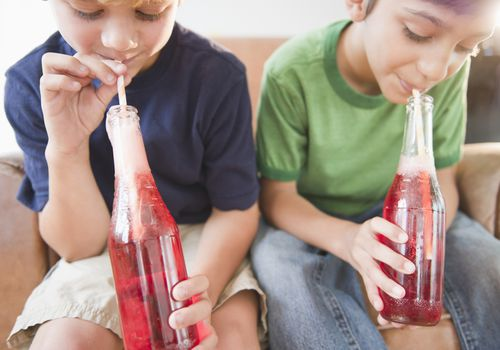children drinking soda