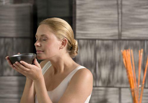 woman holding tea bowl