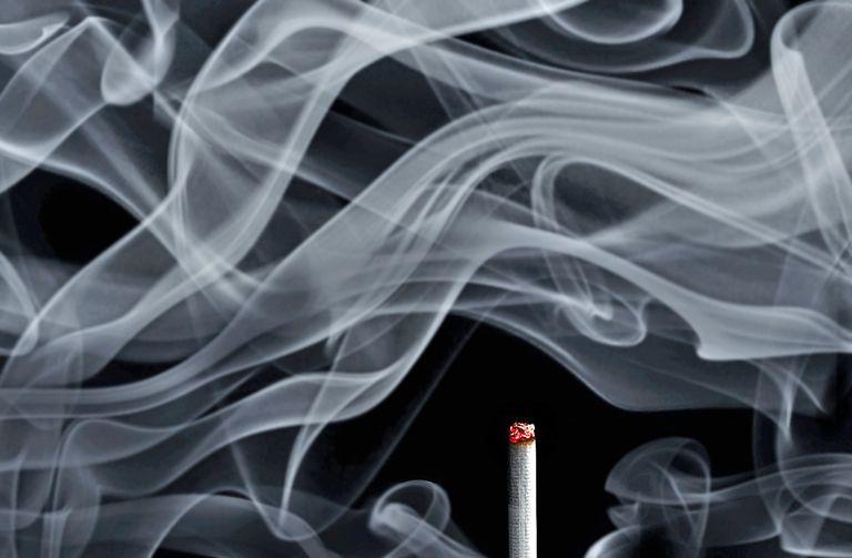cigarette smoke and lit cigarette