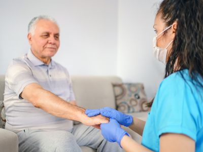 Woman holding patient's hand for health care trust and support