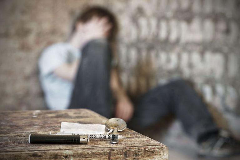Young man with drug paraphernalia