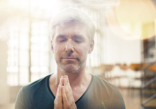 Mature man meditating with his eyes closed